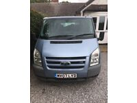 Blue Ford Torneo [9 seater] Mini Bus