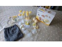 Medela swing breast pump with accessories