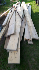 Pile of 2x6 and 2x10 over 8 feet