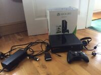 Xbox 360 with cables, wireless controller, headset and games