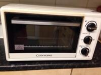 Cook works mini oven.