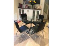 John Lewis glass round table in chrome base with four black leather chairs in very good condition.