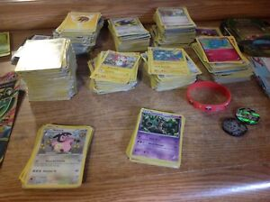 Pokemon cards, coins, shirt, cup, books and bracelet