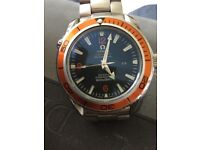 Orange omega seamaster automatic in good used condition.