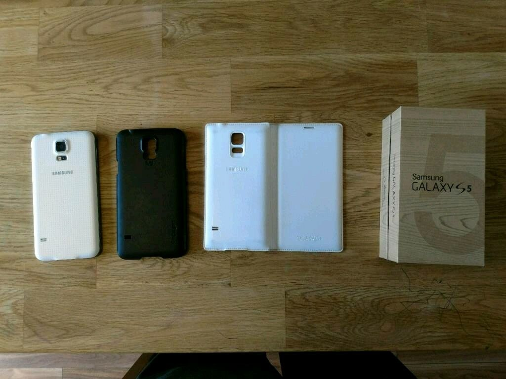 Samsung S5 16gb (unlockedin Wolverhampton, West MidlandsGumtree - Samsung S5 16gb, white, unlocked, excellent condition. Screen is as new with no marks or scratches (screen protector was on from day one), some scuffs on the silver trim around the phone (see photo). Comes with black Spigen case and white Samsung...