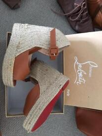 Louboutin wedge shoes size 5 more like 6