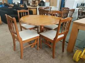 Round pine dining table and 4 chairs