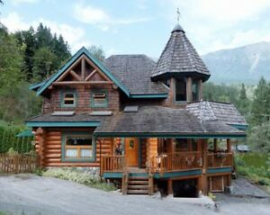 log home in mountains near river