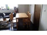 Excellent wooden Dining table and chairs