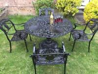 Large cast iron table & chairs