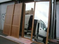 Wood Effect Sliding Wardrobe Doors. 2 Plain and 2 Mirrored with Tracks
