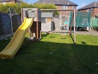 Swing and slide set with tower and climbing board
