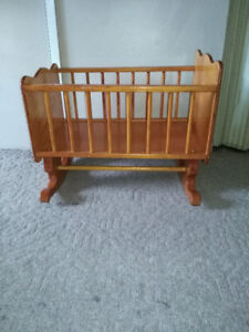 Small wooden rocking crib for babies