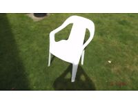 white plastic garden chairs by 4 units