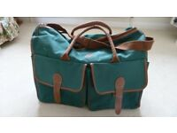 Large, lightweight, green holdall, zipped and carry handles and shoulder strap.