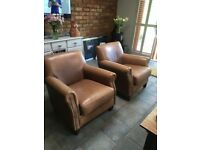 Two Leather Tan Chairs with stud detail