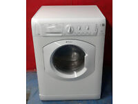 O006 white hotpoint 7kg 1200spin washer dryer comes with warranty can be delivered or collected