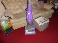 purple and grey dyson in good working order