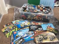 Very large selection of lego with some of the building instructions.