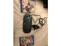 Ps Vita with charger and 32gb memory card and 2 games