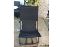Two black garden lounge chairs