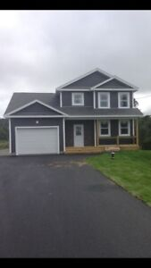 Stunning 2 story home on a treed southern exposure 3/4 acre lot
