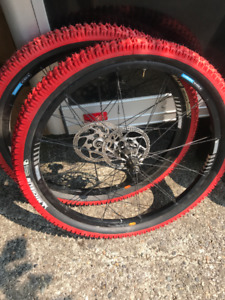 "250.00 Shimano XT M765 26"" Tubeless Wheelset and Michelin Tires"