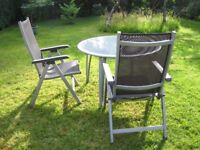 Kettler round outdoor table and chairs in silver/grey
