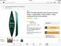 Open two seat canoe in virtually new condition