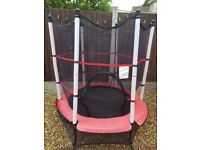 4.5 foot trampoline in red with safety net enclosure