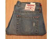 Brand new with tag. Authentic men's True Religion jeans. Straight leg. Waist 34. Distressed look