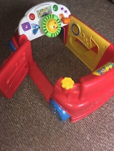 Good condition. Sturdy stationary car with activites