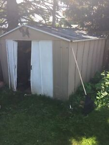 Free storage shed. Rough shape around the door.