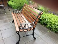 SOLID WOOD BENCH WITH CAST IRON ARMS