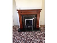 Fire surround with tiled hearth as new condition.
