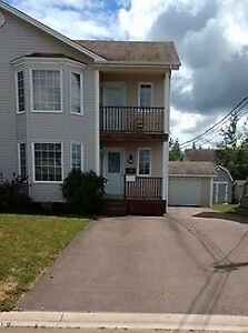 Semi-detached in Dieppe with sunroom and shed