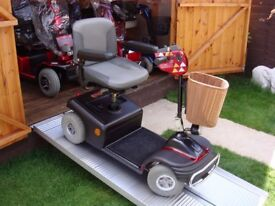 ALL TERRAIN RARE LOOKING STYLISH SOVEREIGN DELUXE SPORT MOBILITY SCOOTER - ( BRAND NEW BATTERIES )