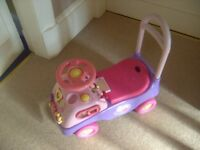 a selection of musical toys for a toddler