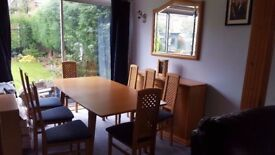 Dining room furniture. Table with 8 chairs, 2 side units and nest of tables