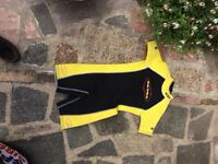 Yellow and black to knee size small wet suit - worn half dozen times