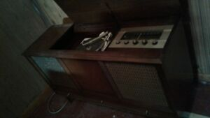 stereo in wooden cabinet
