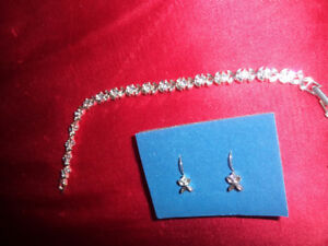brand new fashion bracelet and matching earrings( pierced)