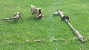 Two antique pumps and a gear box