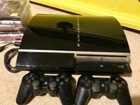 PlayStation 3 (40gb version) with 2 controllers and 8 games