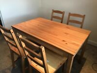 Dining table with 4 chairs. In great condition. Chair padding available at a small additional cost.