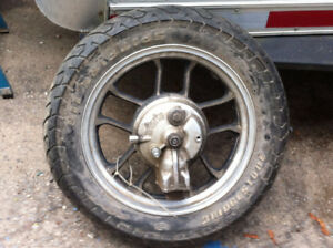 honda vt 500 parts , rear tire and rim, and side cover