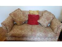 Two three seater fabric sofas, gold colour