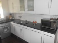 Kitchen for sale. White with brushed steel handles.