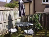 Large garden table & 4 x chairs w/ cushions plus FREE parasol & base
