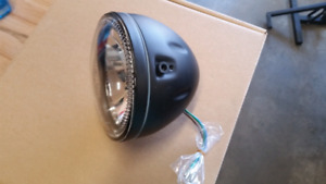 Motorcycle headlight brand new, side mount